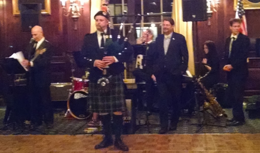 The festivities commence with a special performance by an FDNY bagpiper.